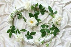 Beautiful white roses ,vintage frames and background of velvet Stock Photo