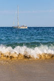 A Beautiful White Sailing Yacht on Waves. Boat, Sea, Waves and Sand. Concept for Tourism. Sailing Ship on the Water. Yachting Stock Images