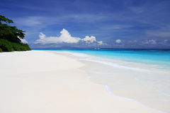Beautiful white sand beach and blue sky Royalty Free Stock Photo