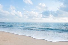 Beautiful white sand beach and ocean waves with clear blue sky. Background stock photography
