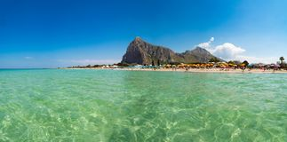 Beautiful white sand beach in San Vito lo Capo, Sicily, Italy wi. Th umbrellas royalty free stock photos