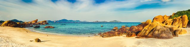 White sand beach. Vietnam. Panorama. Beautiful white sand beach. Stones on a foreground. Landscape of Vietnam. Panorama royalty free stock images
