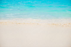 Beautiful white sand beach and tropical turquoise blue sea Stock Images