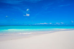 Beautiful white sand beach and turquoise clean water on tropical exotic island Stock Image