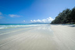 A beautiful white sand beach in vietnam 3. A beautiful white sand beach with small off-shore islands on the horizon in vietnam Royalty Free Stock Image