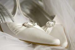 Beautiful white satin shoe Stock Photography