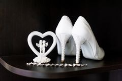 Beautiful white shoes from bride. stock photography