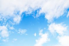 Beautiful white soft fluffy clouds on a blue sky background. Copy space. Beautiful white soft fluffy clouds on a light blue sky background. Copy space royalty free stock photos