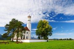Beautiful white St. Coloman pilgrimage church, located near famous Neuschwanstein castle, Germany. Stock Image