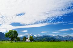 Beautiful white St. Coloman pilgrimage church, located near famous Neuschwanstein castle, Germany. Royalty Free Stock Images