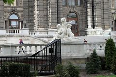 Beautiful white statue of kids in Vienna Stock Photography