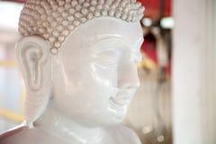 Beautiful white stone Buddha statue head. Buddhism sculpture Royalty Free Stock Image