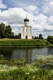 White stone Church of the Intercession on the Nerl with reflection in the water summer day Russia stock images