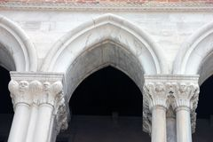 Beautiful white stone pointed arches on facade of Doges Palase in Venice in Italy. Closeup stock photo