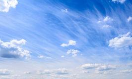 Beautiful White Summer Clouds in the Deep Blue Sky Royalty Free Stock Photo