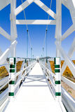 A beautiful white suspension bridge with blue sky royalty free stock image