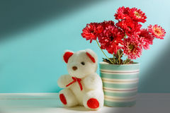 Beautiful White Teddy Bear,pink Flower In Vase On White,green Wood Background. Royalty Free Stock Image
