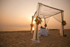 Beautiful white tent on a beach in sunset sky Royalty Free Stock Photos