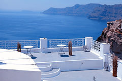 Beautiful white terrace overlooking sea in Oia, Santorini, Cycla Royalty Free Stock Photography