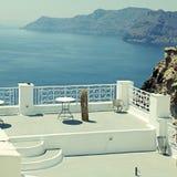 Beautiful white terrace overlooking sea in Oia, Santorini, Cyclades, Greece. Beautiful view with white terrace overlooking sea in Oia, Santorini, Cyclades stock image
