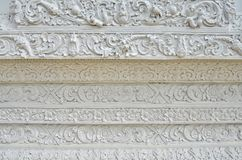 Beautiful white Thai pattern styles close up. Beautiful white Thai pattern styles on the wall of temple in Thailand stock photos