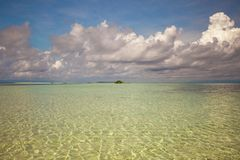 Beautiful white tropical beach on desert island Royalty Free Stock Images