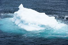 Iceberg with turquoise shining water, Greenland Royalty Free Stock Photos