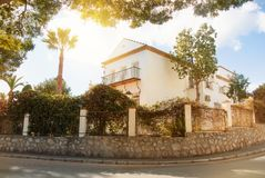 Beautiful white typical mediterranean spanish house with high st Stock Photos