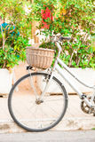 Beautiful white vintage bicycle near the house on italian street Stock Photo