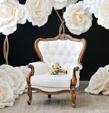 Beautiful white wedding bouquet. On the armchair Royalty Free Stock Photography