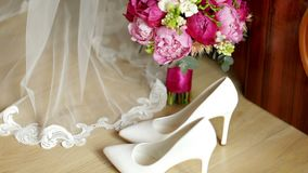 Beautiful white wedding bouquet with bride sitting in the background. Shallow dof. Close-up stock video