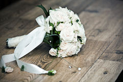 Beautiful white wedding bouquet. On the floor Royalty Free Stock Photos