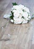 Beautiful white wedding bouquet. On the floor Stock Photos