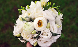 Beautiful white wedding bouquet. On green background Royalty Free Stock Image