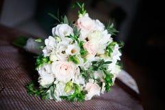 Beautiful white wedding bouquet. Lays on sopha Royalty Free Stock Photos