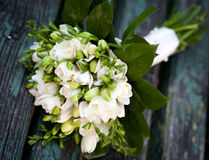 Beautiful white wedding bouquet. On wooden background Royalty Free Stock Photo