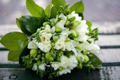 Beautiful white wedding bouquet. On wooden background Stock Photo