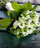 Beautiful white wedding bouquet. On wooden background Stock Photos