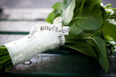 Beautiful white wedding bouquet. On wooden background Royalty Free Stock Photography