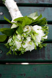 Beautiful white wedding bouquet. On wooden background Stock Images