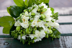 Beautiful white wedding bouquet. On wooden background Stock Photography