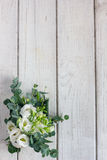 Beautiful white wedding bouquet. On wooden board Royalty Free Stock Photo