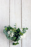 Beautiful white wedding bouquet. On wooden board Stock Images