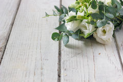 Beautiful white wedding bouquet. On wooden board Royalty Free Stock Image