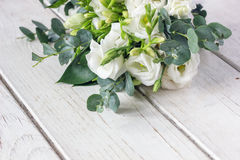 Beautiful white wedding bouquet. On wooden board Royalty Free Stock Photography