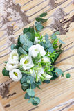 Beautiful white wedding bouquet. On wooden board Stock Image