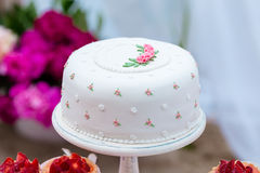 Beautiful white wedding cake with flowers outdoor. Shabby chic style Stock Photo