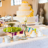 Sugared almonds. Beautiful white wedding cakes with different decorations Stock Photos