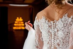 Beautiful white wedding dress with embroidery close-up shot royalty free stock photography