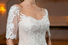 Beautiful white wedding dress with embroidery close-up shot stock image